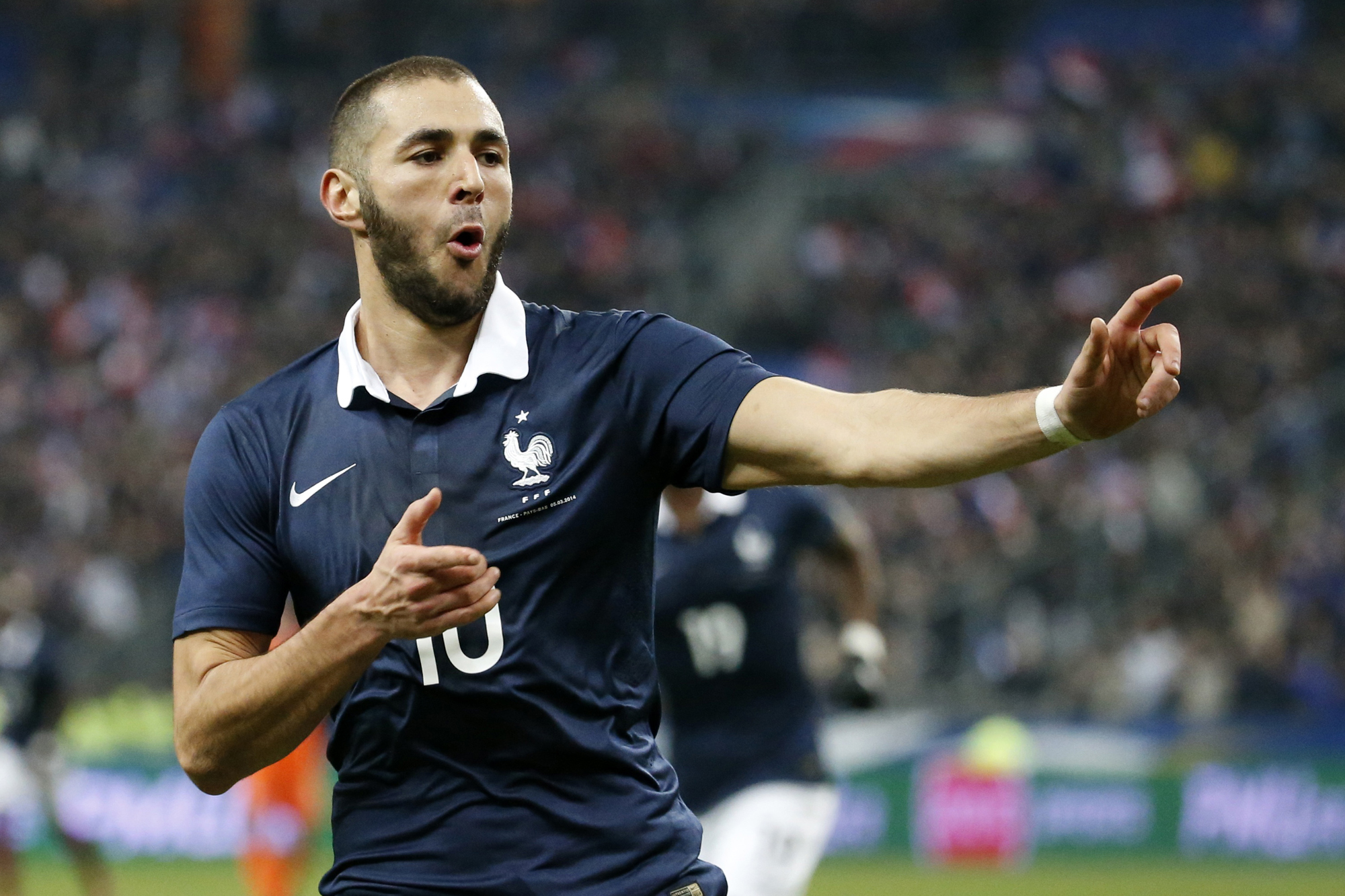 France's Karim Benzema celebrates after scoring againts the Netherlands during their international friendly soccer match at the Stade de France in Saint-Denis near Paris, March 5, 2014. REUTERS/Benoit Tessier (FRANCE - Tags: SPORT SOCCER) - RTR3G379