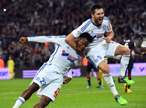 Marseille's Belgian midfielder Michy Batshuayi (L) celebrates with Marseille's French forward Andre-Pierre Gignac (R) after scoring a goal on November 23, 2014 at the Velodrome stadium in Marseille, southern France, during the French L1 football match Marseille vs Bordeaux. AFP PHOTO / ANNE-CHRISTINE POUJOULAT (Photo credit should read ANNE-CHRISTINE POUJOULAT/AFP/Getty Images)