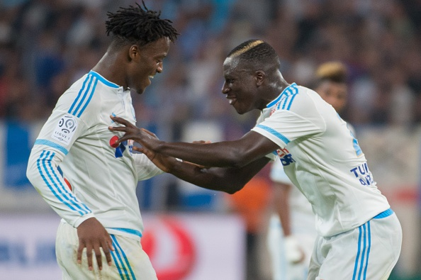 Marseille's Belgian forward Michy Batshuayi (L) is congratulated by Marseille's French defender Benjamin Mendy after scoring a goal during the French L1 football match Olympique de Marseille vs Troyes on August 23, 2015 at the Velodrome stadium in Marseille, southern France. AFP PHOTO / BERTRAND LANGLOIS (Photo credit should read BERTRAND LANGLOIS/AFP/Getty Images)