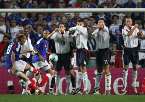 BEST OF ENGLAND FRANCE AT EURO 2004. French captain Zinedine Zidane (L) scores France's equaliser against England, 13 June 2004 during their opening match at the European Nations football championships at the Estadio da Luz in Lisbon. France and England are competing in Group B with Croatia and Switzerland. AFP PHOTO FRANCK FIFE (Photo credit should read FRANCK FIFE/AFP/Getty Images)