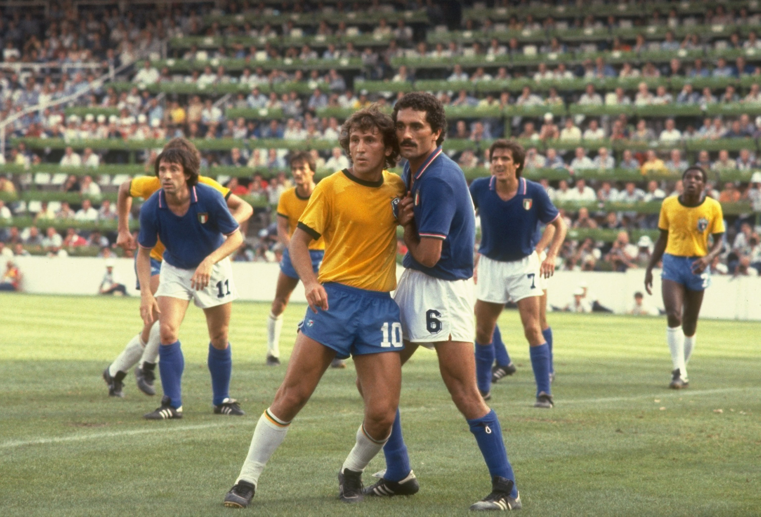 5 Jul 1982:  Zico (left) of Brazil and Claudio Gentile of Italy mark each other during the World Cup Second Round match at the Sarria Stadium in Barcelona, Spain. Italy won the match 3-2.  Mandatory Credit: Allsport UK /Allsport