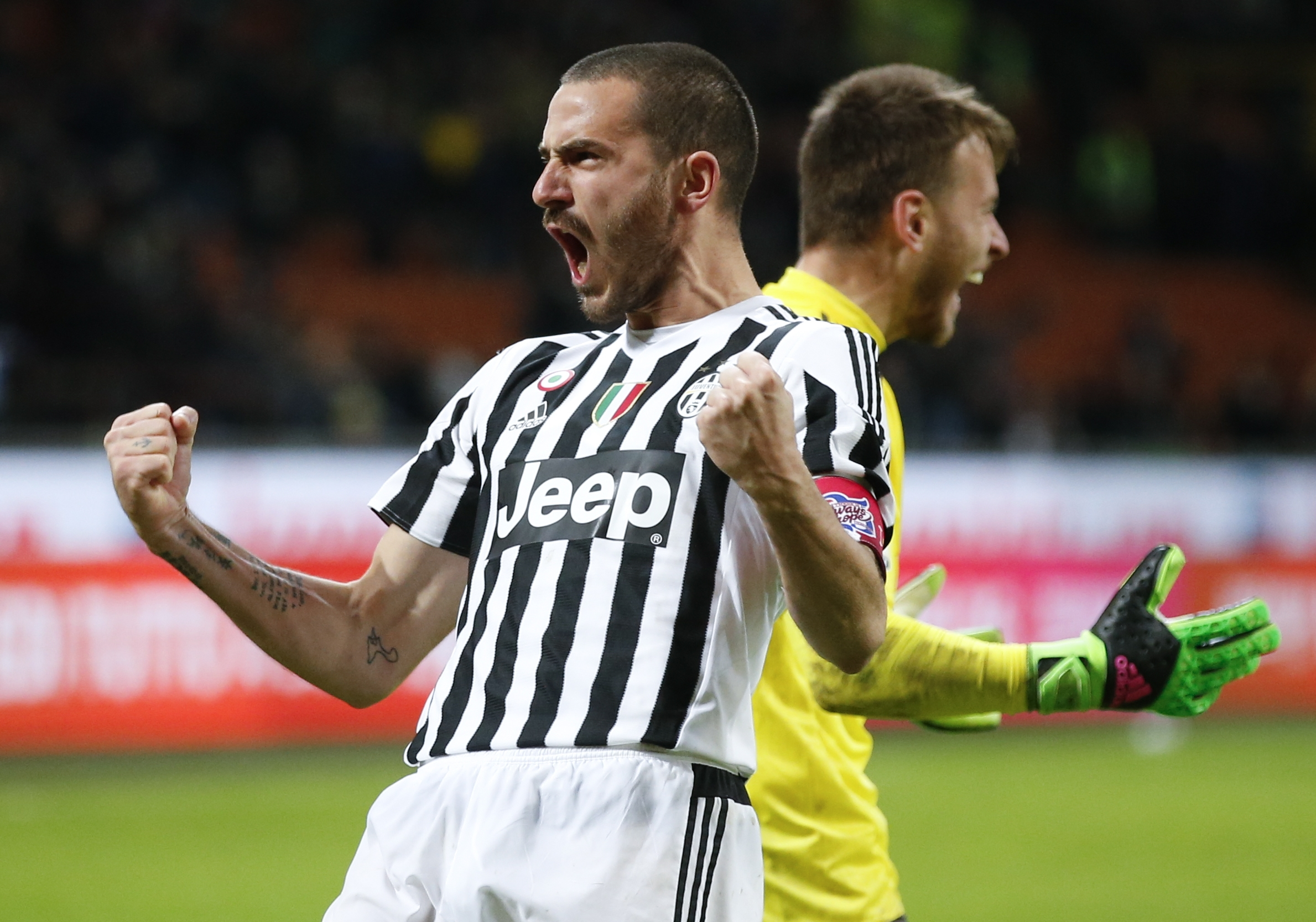 Juventus' Leonardo Bonucci celebrates past his teammate goalkeeper Neto after scoring decisive goal that gave his team a 5-2 win over Inter Milan,  a penalty shootout during the Italian Cup second leg semifinal soccer match, at the San Siro stadium in Milan, Italy, Wednesday, March 2, 2016. (AP Photo/Antonio Calanni)