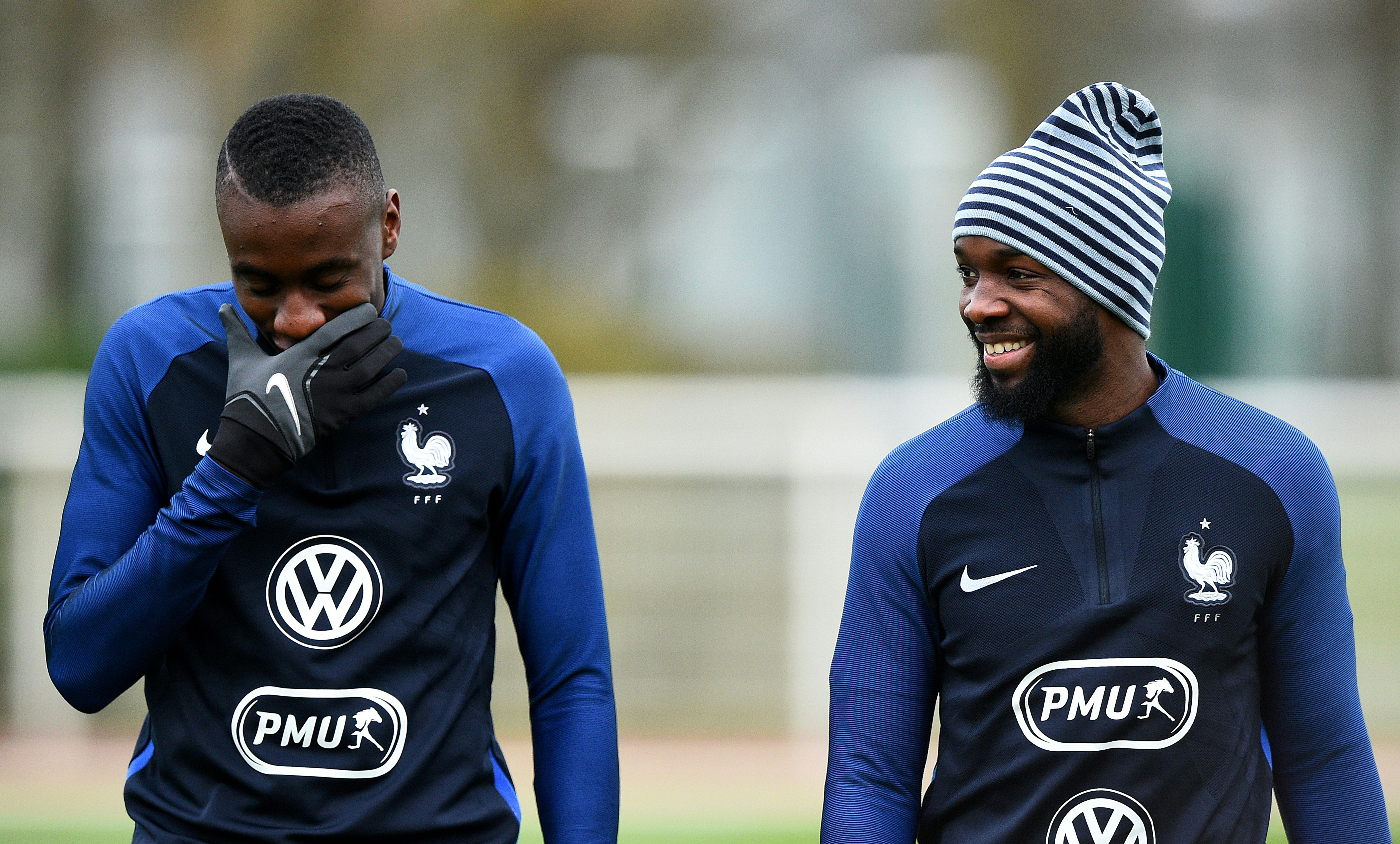 France's midfielder Blaise Matuidi (L) jokes with midfielder Lassana Diarra during a training session in Clairefontaine-en-Yvelines on March 26, 2016 ahead of a friendly football match against Russia.  / AFP / FRANCK FIFE        (Photo credit should read FRANCK FIFE/AFP/Getty Images)