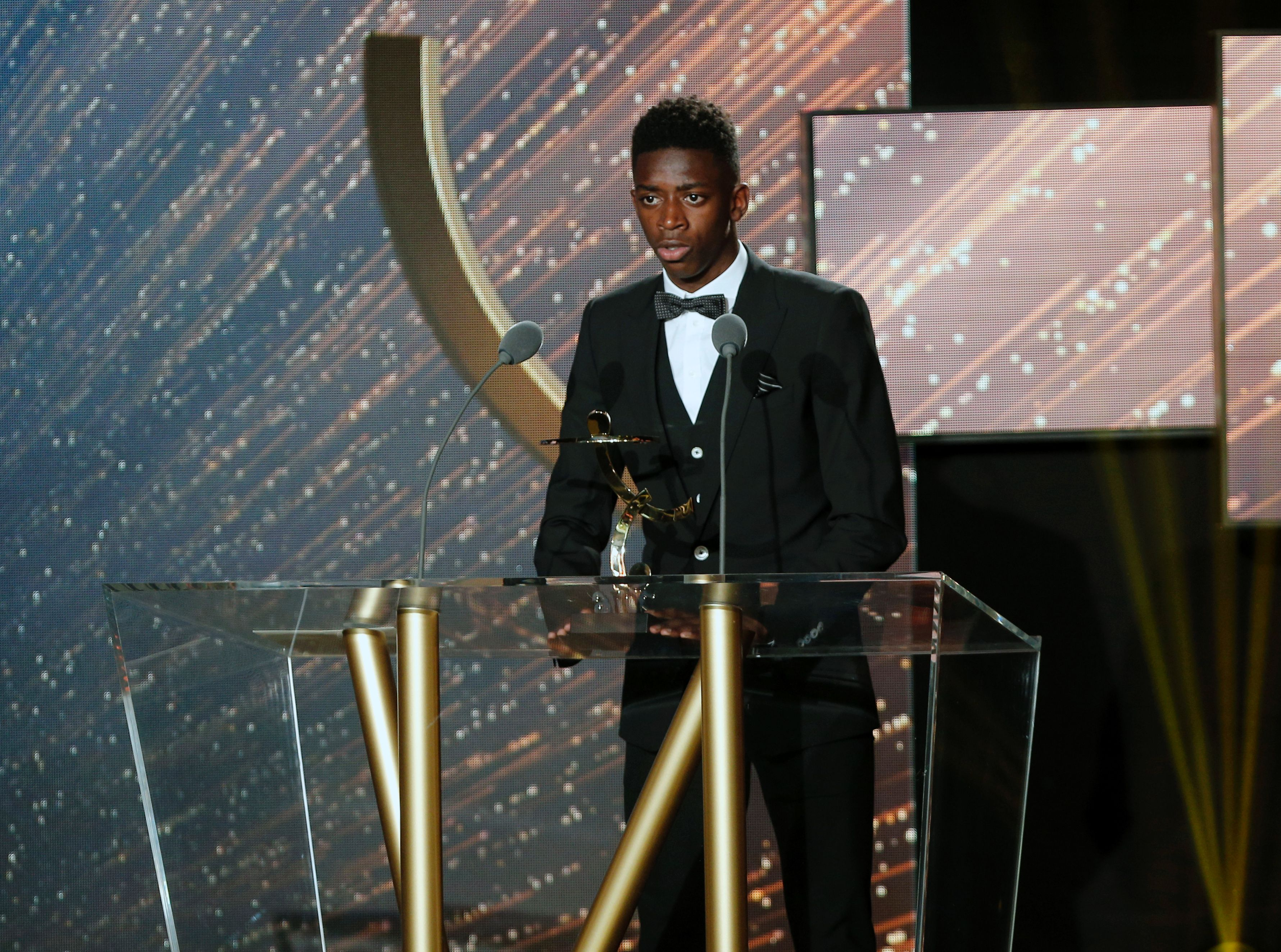 French Rennes' forward Ousmane Dembele receives the Ligue 1 2015-2016 young player of the year award during the 25th professionnal football players national union's (Union Nationale des Footballeurs professionnels, UNFP) trophies cemenony in Paris on May 8, 2016. / AFP / FRANCOIS GUILLOT        (Photo credit should read FRANCOIS GUILLOT/AFP/Getty Images)