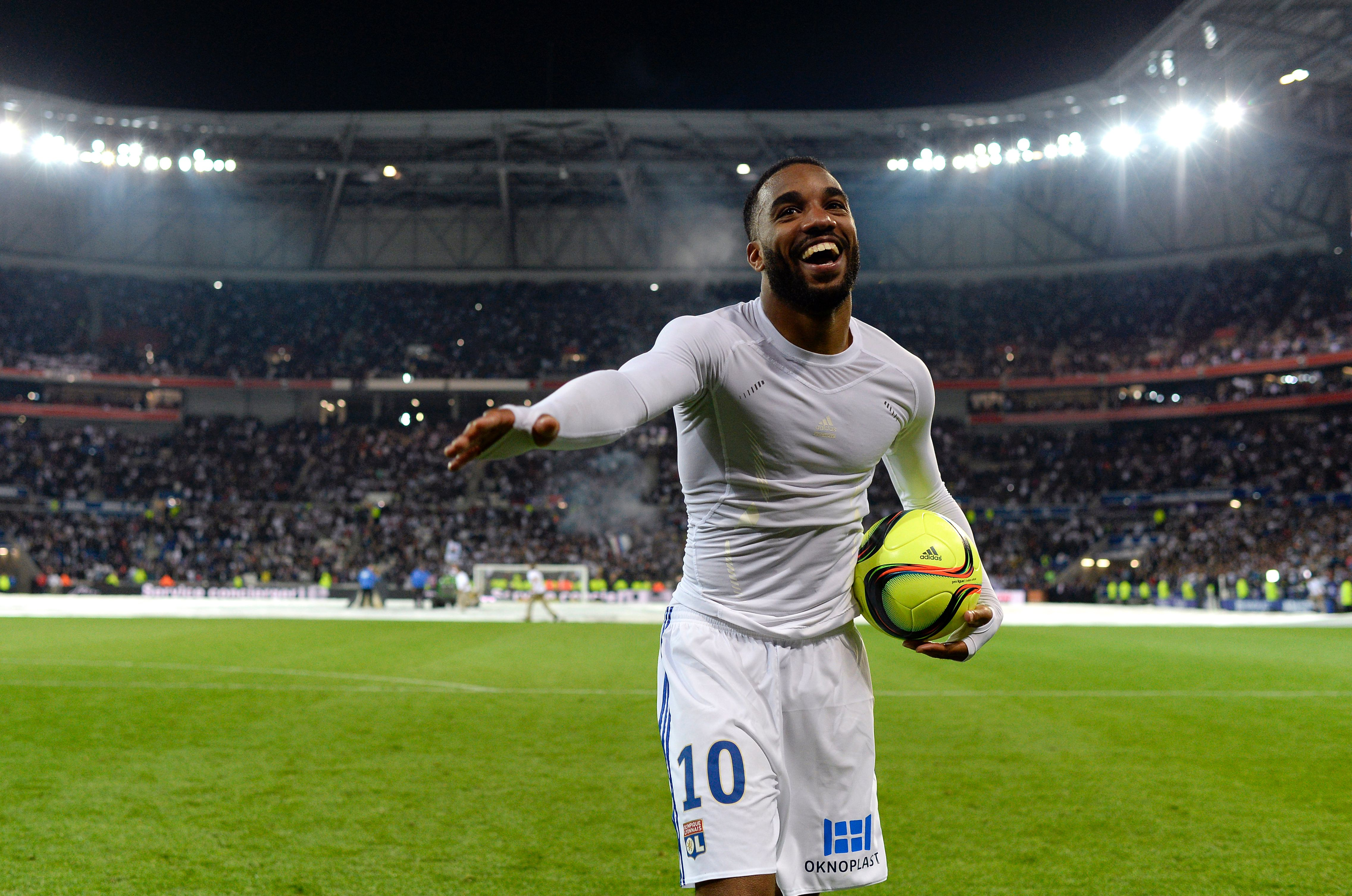 Lyon's French forward Alexandre Lacazette celebrates after the French L1 football match between Lyon (OL) and Monaco (ASM) at the Parc de l'Olympique Lyonnais in Decines-Charpieu, central eastern France, on May 7, 2016. Lyon won the match 6-1. / AFP / ROMAIN LAFABREGUE        (Photo credit should read ROMAIN LAFABREGUE/AFP/Getty Images)