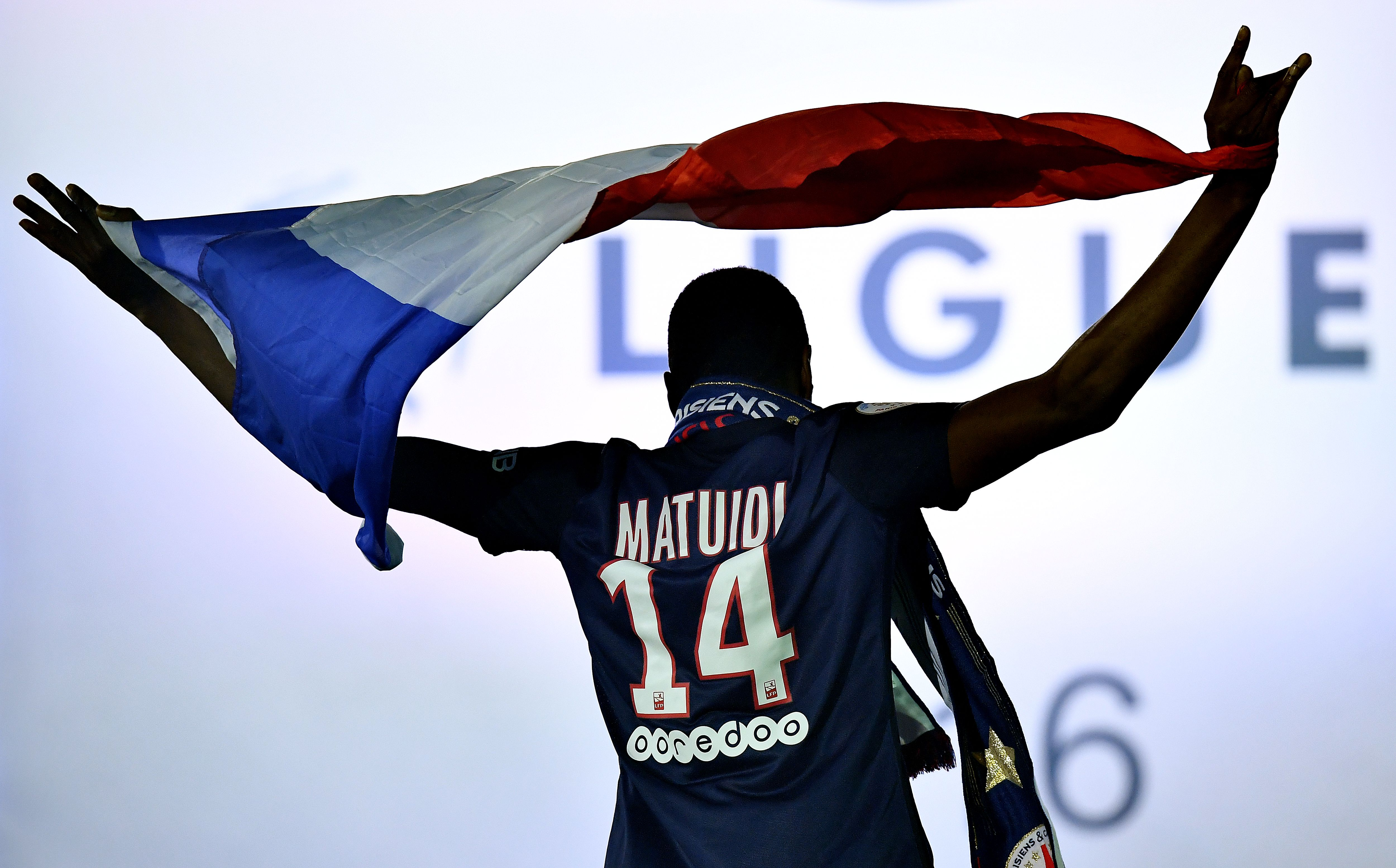 Paris Saint-Germain's French midfielder Blaise Matuidi arrives on the podium after winning the French L1 title at the end of the French L1 football match Paris Saint-Germain (PSG) vs Nantes on May 14, 2016 at the Parc des Princes stadium in Paris.    / AFP / FRANCK FIFE        (Photo credit should read FRANCK FIFE/AFP/Getty Images)