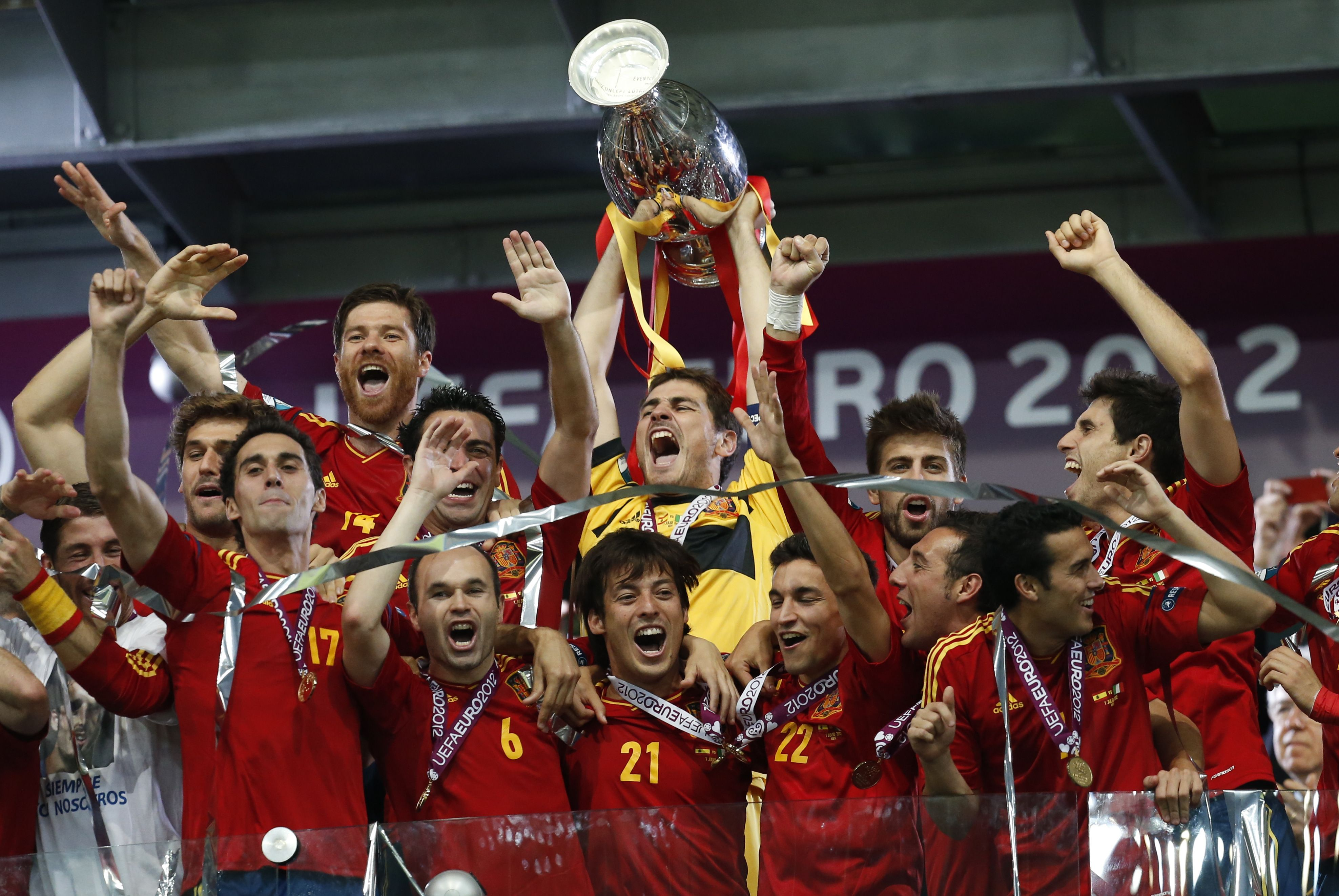 Spain goalkeeper Iker Casillas lifts the trophy after the Euro 2012 soccer championship final  between Spain and Italy in Kiev, Ukraine, Sunday, July 1, 2012. (AP Photo/Matthias Schrader)