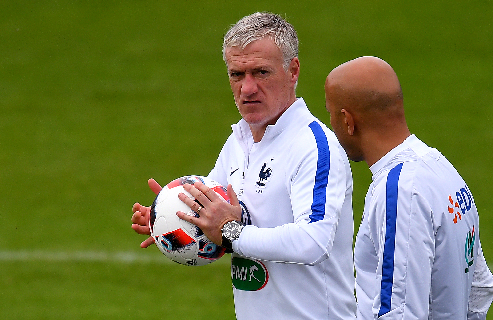 "France's coach Didier Deschamps (L) checks the new official ball ""Fracas"" for the play-offs during a training session in Clairefontaine-en-Yvelines on June 21, 2016, during the Euro 2016 football tournament.   / AFP / FRANCK FIFE        (Photo credit should read FRANCK FIFE/AFP/Getty Images)"