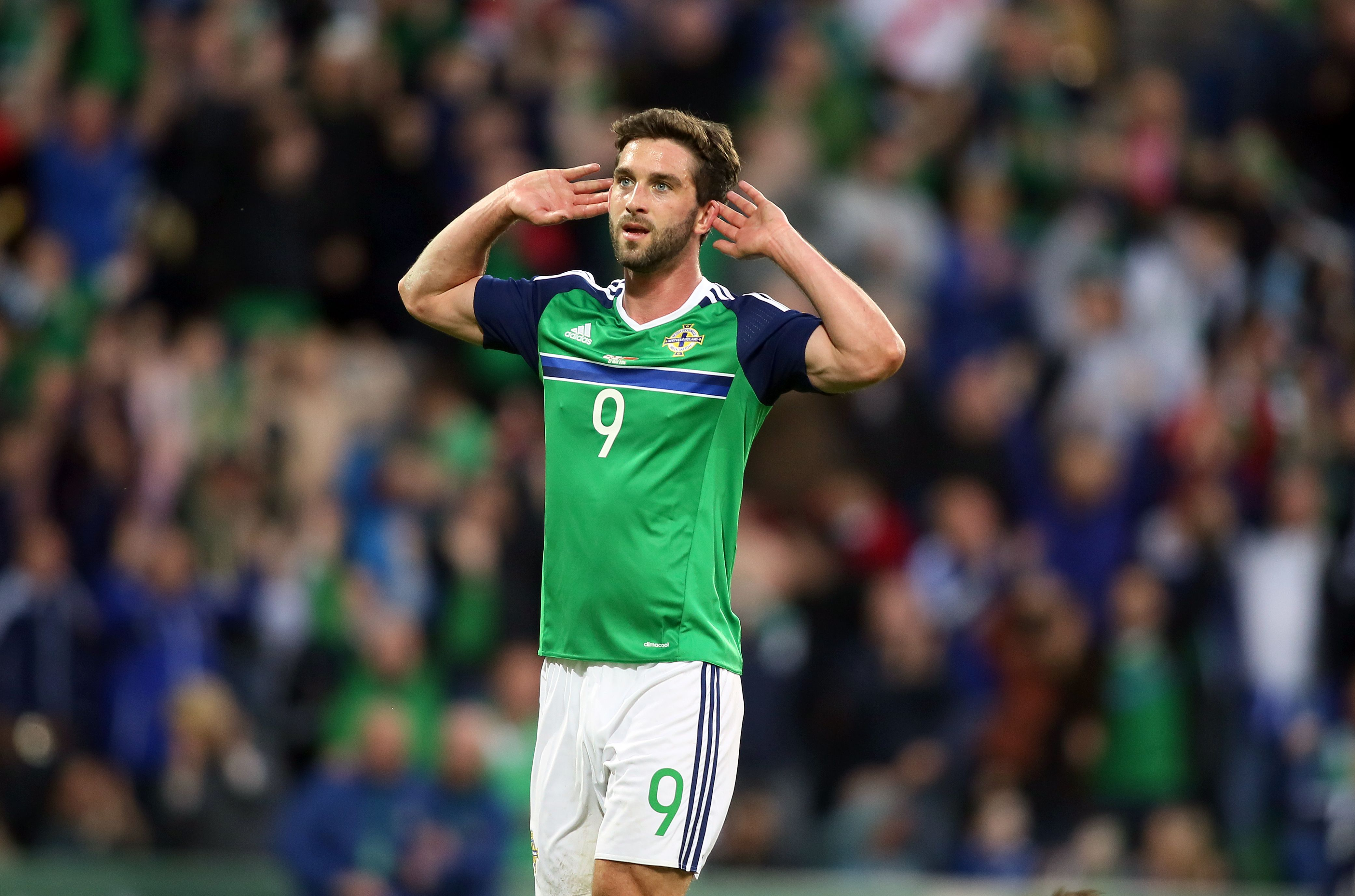 Northern Ireland's Will Grigg celebrates after scoring the team's third goal against Belarus during an international friendly football match between Northern Ireland and Belarus at Windsor Park in Belfast, Northern Ireland, on May 27, 2016. / AFP / PAUL FAITH        (Photo credit should read PAUL FAITH/AFP/Getty Images)