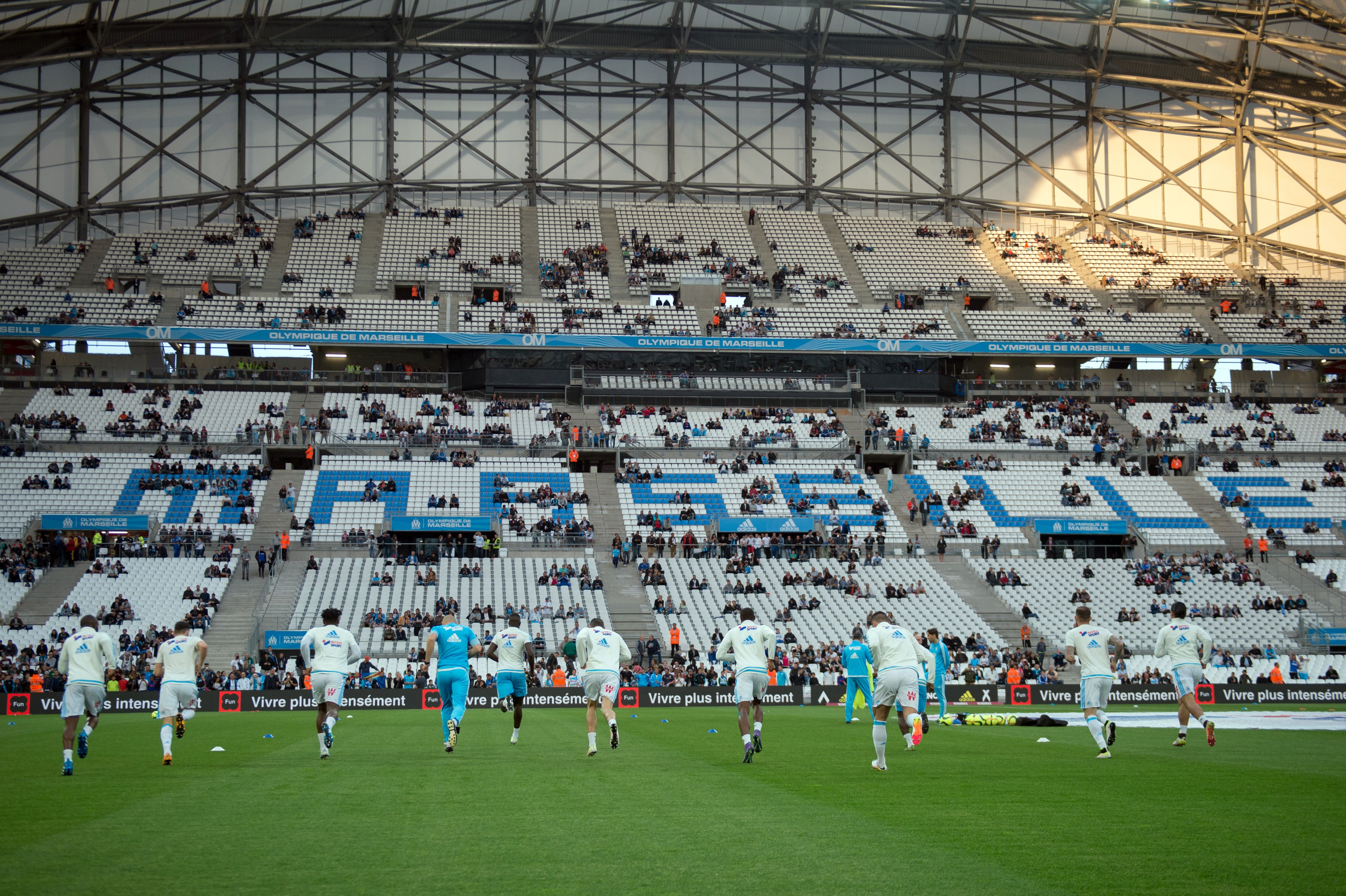 Marseille's players warm up prior to the French L1 football match between Marseille and Reims on May 7, 2016 at the Velodrome stadium in Marseille, southern France. AFP PHOTO / BERTRAND LANGLOIS / AFP / BERTRAND LANGLOIS        (Photo credit should read BERTRAND LANGLOIS/AFP/Getty Images)