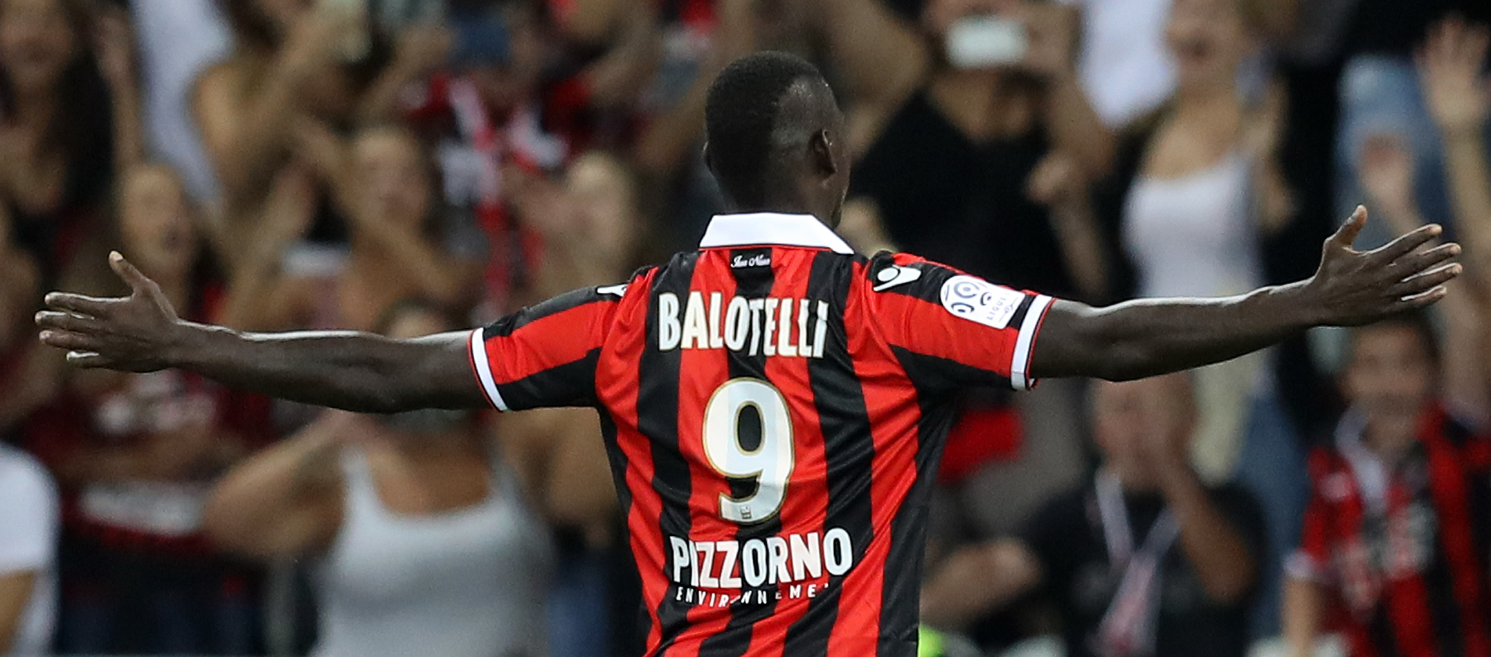 Nice's Italian forward Mario Balotelli celebrates after scoring a goal during the French L1 football match Nice vs Marseille on September 11, 2016 at the Allianz Riviera stadium in Nice, southeastern France. / AFP / VALERY HACHE        (Photo credit should read VALERY HACHE/AFP/Getty Images)